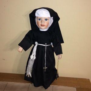 Nun porcelain doll